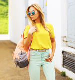 Summer street fashion, stylish hipster girl in sunglasses. Posing in the city Stock Image