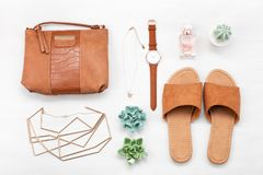Summer street style. Fashion summer girl clothes set, accessories. Trendy slippers, handbag clutch, watch. Summer lady. Creative urban overhead summer top view royalty free stock images