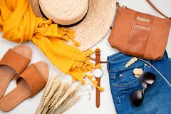 Summer street style. Fashion summer girl clothes set, accessories. Trendy sunglasses, scarf, handbag clutch, hat. Summer lady. Creative urban overhead summer royalty free stock images
