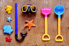 Summer stuff, such as a diving or beach toys, on a rustic wooden. High-angle shot of a rustic wooden table full of summer stuff, such as a starfish, a diving royalty free stock photo