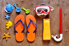 Summer stuff, such as a pair of flip-fllops, a diving mask or a Royalty Free Stock Image