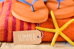 Summer stuff and word summer in a brown label Stock Images