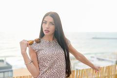 Summer style outdoor fashion portrait of young beautiful woman having fun on vacation Stock Photos
