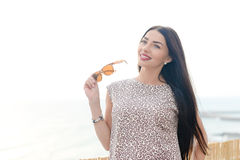 Summer style outdoor fashion portrait of young beautiful woman having fun on vacation Royalty Free Stock Photo