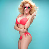 Summer style photo of young blonde girl in bikini. Royalty Free Stock Image