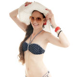 Summer stylish girl in swimsuit and hat. Royalty Free Stock Image