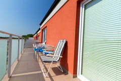 Summer sun at apartment balcony. With deck chairs Royalty Free Stock Image