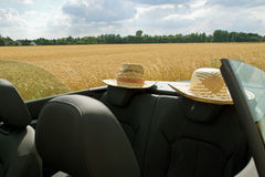 Summer, Sun, Car with two straw hats Stock Photography