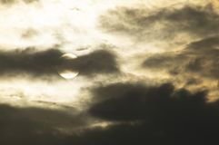 The summer sun hid behind the clouds. Illuminating them from the back side stock photos