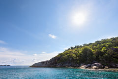 Summer sun over the island and sea Stock Photography