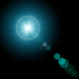 Summer sun with realistic lens flare lights and glow on black background. Graphic illustration Royalty Free Stock Photo