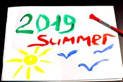 Summer 2019 and sun and seagulls are painted with brush and gouache on white album sheet royalty free stock image