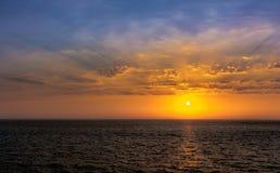 Summer sun sets off the coast of Mumbai Stock Photo