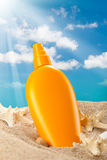 Summer sunbath - suntan oil Stock Images