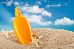 Summer sunbath - suntan oil Royalty Free Stock Images