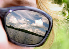 Summer on sunglasses. Lake reflection on sunglasses Stock Photography