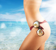 Summer sunglasses. Girl with sunglasses in the red swimsuit Stock Photography