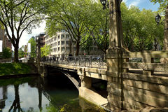 Summer sunny bright perspective view of the historic old bridge Stock Photo