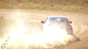 Dusty Turn of the Rally Track. Slow Motion stock footage
