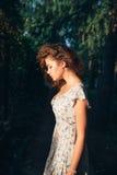 Summer sunny girl. The summer beautiful sunny girl in a garden Stock Image