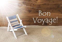 Summer Sunny Greeting Card, Bon Voyage Means Good Trip. Sunny Summer Greeting Card With Sand And Aged Wooden Background. French Text Bon Voyage Means Good Trip Stock Photos