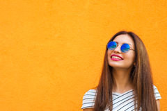 Summer sunny lifestyle fashion portrait of young stylish hipster woman in sunglasses, looking up, trendy shirt. copy Stock Photography