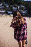 Summer sunny lifestyle fashion portrait of young stylish hipster woman walking on beach,wearing cute trendy outfit Royalty Free Stock Image