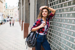 Summer sunny lifestyle fashion portrait of young stylish hipster woman walking on street. Summer lifestyle fashion portrait of young stylish hipster woman Royalty Free Stock Photography