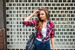 Summer sunny lifestyle fashion portrait of young stylish hipster woman walking on street. Summer lifestyle fashion portrait of young stylish hipster woman Royalty Free Stock Image