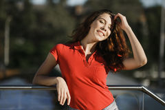 Summer sunny lifestyle fashion portrait of young woman posing in the city.  Royalty Free Stock Photos