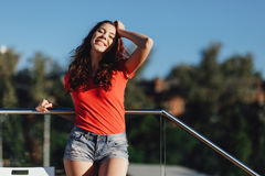 Summer sunny lifestyle fashion portrait of young woman posing in the city.  Royalty Free Stock Photo