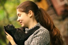 summer sunny photo of teenager girl hug cuddle cat close up outdoor photo stock photo