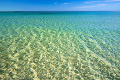 Summer sunny sea beach. Sunny summer sea beach with crystal clear water, sand seabed and blue sky Royalty Free Stock Photography