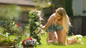 Summer sunny shiny holidays memories - female teen girl smiling enjoying flowers decorations in the green magic grassy stock footage
