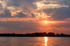 Summer Sunrise With Beautiful Cloudy Sky Over Lake Water Stock Photography