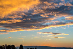 Summer sunrise morning clouds in dramatic view Stock Photos