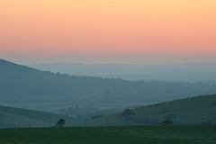 Summer sunrise over countryside landscape. Beautiful sunrise over English countryside landscape in Summer Royalty Free Stock Photos