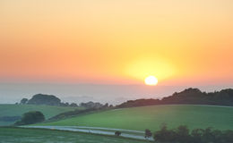 Summer sunrise over English countryside landscape. Beautiful sunrise over English countryside landscape in Summer Stock Photos
