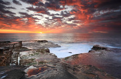 Summer sunrise over Maroubra and reflections Royalty Free Stock Images