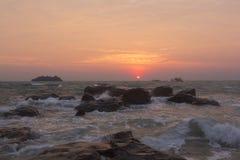 Summer sunrise seascape on tropical island Koh Rong in Cambodia. Summer sunrise seascape on tropical beach with rocks in Koh Rong Island near Sihanoukville Royalty Free Stock Photography