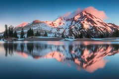 Summer Sunrise South Sister mountains in central Oregon near Bend are reflected in Green Lakes. Mountains in the cascade Range royalty free stock photos