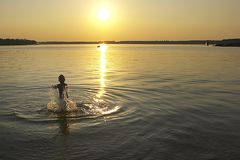 Summer sunset. Boy and summer sunset Royalty Free Stock Images