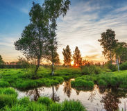 Summer sunset around field and river Stock Image