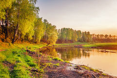 Summer sunset around field and river Stock Images