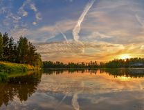 Summer sunset on the Bank of the quarry. The fading light of the Royalty Free Stock Image