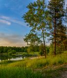 Summer sunset on the Bank of the quarry. The fading light of the Stock Images