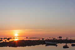 Summer sunset with a boat at sea Stock Photo
