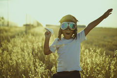 Summer sunset, Boy playing to be airplane pilot, funny guy with Stock Images