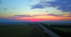 Summer Sunset Evening Above road and Field Landscape. drone flight stock footage