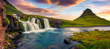 Summer sunset on famous Kirkjufellsfoss Waterfall and Kirkjufell. Mountain. Colorful evening panorama of Snaefellsnes peninsula, Iceland, Europe. Artistic style Royalty Free Stock Photo